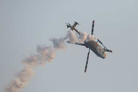 Advance light helicopters (ALH) from the Indian Air Force's  team performs during the 70th anniversary of Sri Lankan Air Force in Colombo.
