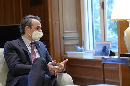 Greek Prime Minister Kyriakos Mitsotakis, during the meeting with the Vice President of the European Commission and Commissioner for thePromotion of the European Lifestyle Margaritis Schinas at Maximou Mansion.