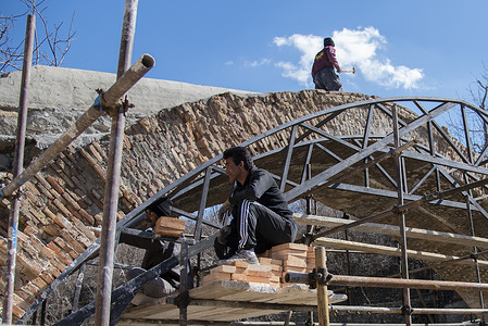 Workers repair the Kan historic brick bridge. The Kan historic brick bridge dates back to 200 years ago in Kan historic district. The restoration project of this historic bridge has started.