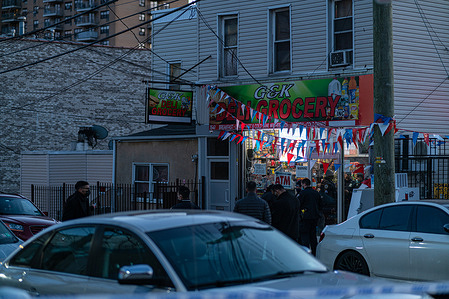 Detectives investigate a possible fatal shooting in a Bronx bodega.