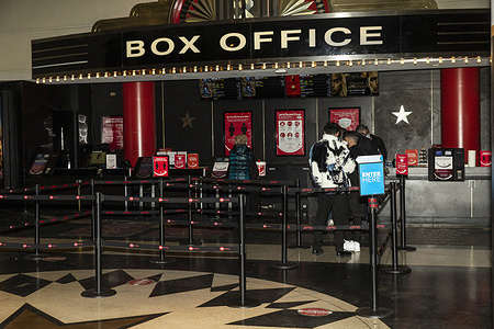 As per Governor Andrew Cuomo order movie theaters in the city were reopened at 25% capacity as seen at AMC Lincoln Square. March 5th was the first day when moviegoers were allowed to go inside theaters. People buying tickets seen on this image.