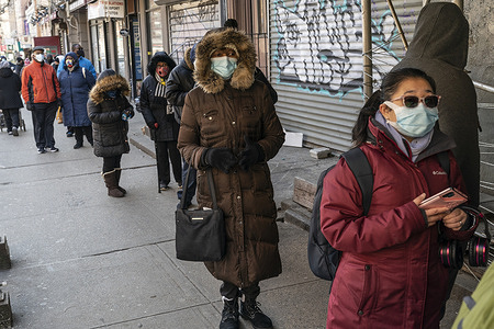 People waiting in line at community-based pop-up vaccination site at Canaan Baptist Church of Christ in Harlem. Pop-up vaccination sites were organized on order by New York State Governor Andrew Cuomo in mostly underservedneighborhoods to ensure fairness and equity in the vaccine distribution process.Governor administration was collaborating with SOMOS Community Care to vaccinate people.