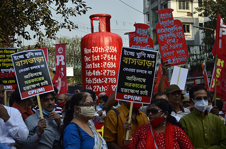 Supporters of Left Front and Congress party during a protest rally against  the hike in fuel prices in Kolkata.