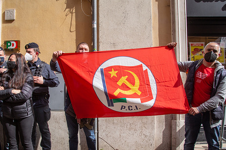 """Some exponents of """"Sardine"""" Movement show a flag of the old Italian Communist Party in front of the entrance to national headquarters of Democratic Party. About twenty exponents of the """"Sardine"""" Movement demonstrated under the national headquarters of the Democratic Party, led by Mattia Santori and Jasmine Cristallo, after the resignation of Secretary Nicola Zingaretti"""