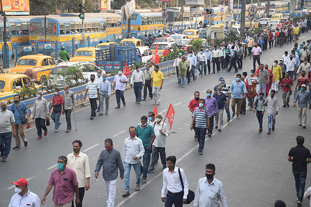 Member of Left Front and Congress political party during a protest rally against hike in fuel price in Kolkata.
