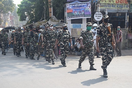 Paramilitary personnel on a route march and patrolling exercise ahead of Assembly Elections at South Kolkata.