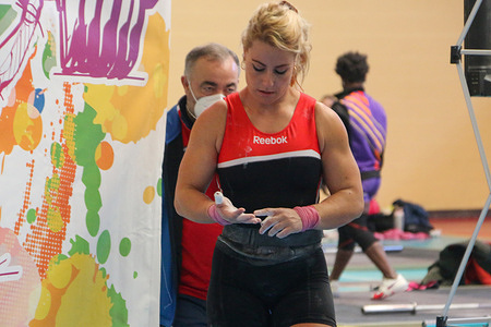 Weightlifter Lydia Valentin prepares to make her first attempt during the Spanish Weightlifting Cup at the Margarita Ramos Pavilion in Leon.