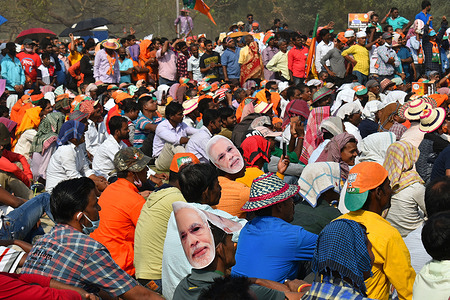 BJP (Bharatiya Janata Party) members participate in the brigade rally ahead of the West Bengal state legislative assembly elections at Kolkata.