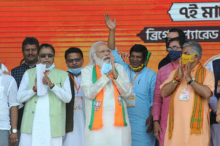 Prime Minsiter Narendra Modi greets Bharatiya Janta Party or BJP activists during a election campaign rally at Brigade Parade Ground ahead of state legislative assembly election.