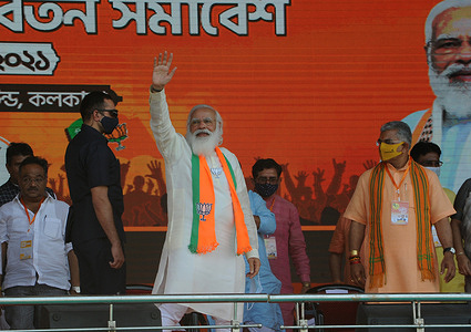 Prime Minister Narendra Modi being greeted during public meeting organised by BJP ahed of West Bengal assembly elections,at Brigade ground in Kolkata.