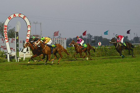 Pakistani Jockeys ride their horses during the JDW Pakistan annual Derby Horse Race at the Lahore Race Club in Provincial Capital Lahore.