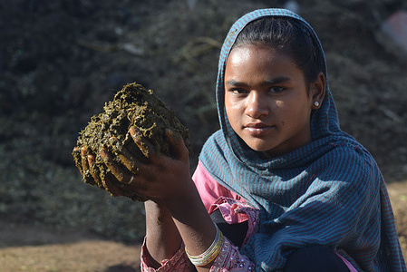 Pakistani female labourer makes clay bricks at a brickyard of Brick Kiln at the area of batapur Lahore, ahead of International Women's Day which is celebrated every year on March 8.