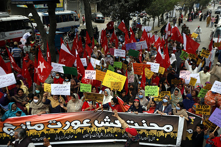 Pakistani activists of trade unions march in rally on the eve of the International Women's Day in Lahore.