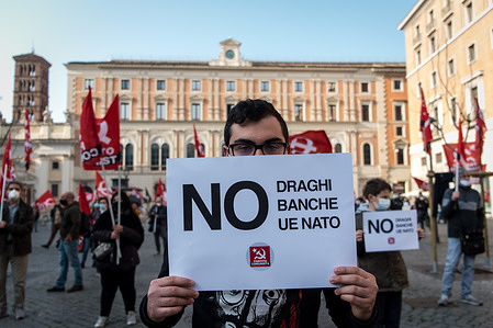 Demonstration of Italian Communist Party by Marco Rizzo protest against Draghi's government, calling it a government of banks and Confindustria. Demonstrators gathered in Piazza San Silvestro near the government headquarters to protest against Premier Mario Draghi, former president of the European Central Bank.