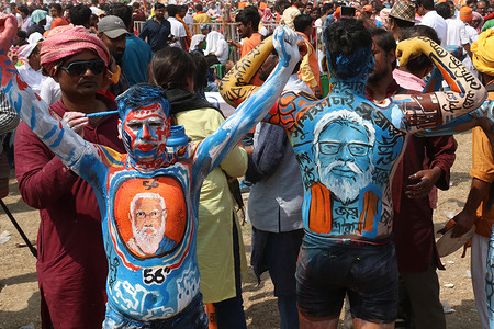 A Bharatiya Janata Party (BJP) supporter shows his body painted during a mass rally addressed by India's Prime Minster Narendra Modi ahead of the state legislative assembly elections at the Brigade Parade ground in Kolkata on March 7, 2021.